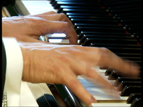 jools holland interview / playing piano; holland playing piano sot - jools holland stock-videos und b-roll-filmmaterial
