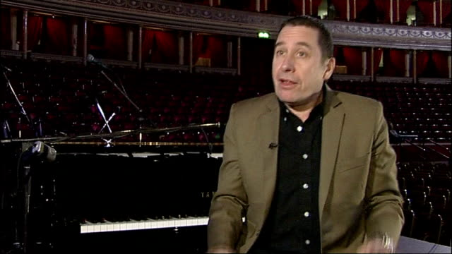 vídeos y material grabado en eventos de stock de jools holland interview sot talks of being born after his mother and father were excited at the 100 club after seeing humphrey lyttleton and his band... - jools holland