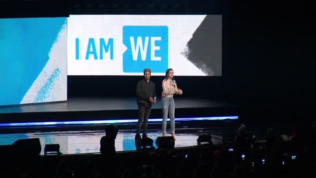 jordan fisher and bailee madison greet the audience at we day new york welcome to celebrate young people changing the world at radio city music hall... - radio city music hall stock-videos und b-roll-filmmaterial
