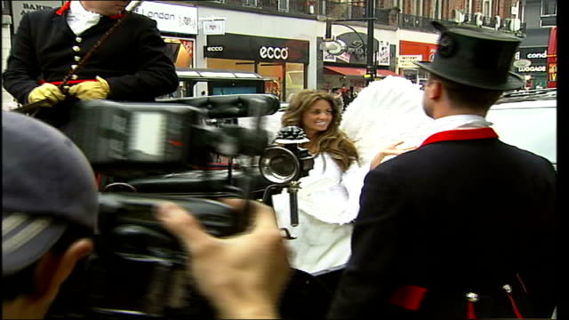 london selfridges ext * * music overlaid on the following shots sot * * photography * * katie price arriving for booksigning and photocall in a... - book signing stock videos & royalty-free footage