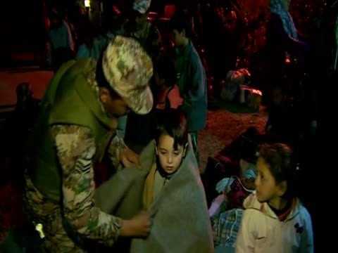Jordan soldier wraps Syrian child refugee in a blanket Zaatari camp Jordan