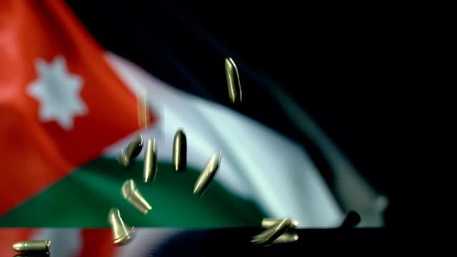 jordanian flag behind bullets falling in slow motion - dinar stock videos & royalty-free footage