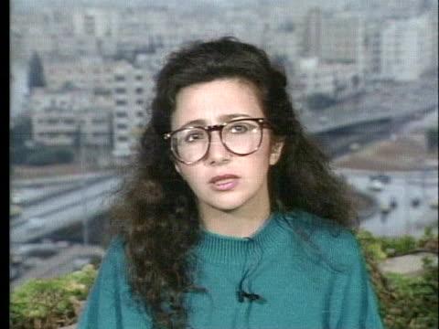 vídeos de stock, filmes e b-roll de jordanian journalist lamis adoni talks about iraqi civilians in baghdad trying to go about living normal lives during operation desert storm. - civil