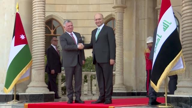Jordanian King Abdullah II meets Iraqi President Barham Saleh in Baghdad in the monarch's first trip to Iraq in more than a decade