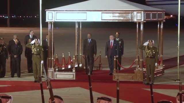 Jordanian King Abdullah II welcomes Sudanese President Omar alBashir upon his arrival at Queen Alia International Airport in Amman Jordan on March 29...