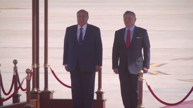 Jordanian King Abdullah II welcomes Yemeni President Abd Rabbuh Mansour Hadi upon his arrival at Queen Alia International Airport in Amman Jordan on...