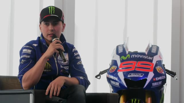 jorge lorenzo answers a question on his switch from hjc helmets to shark helmets during a yamaha motogp team presentation on january 18, 2016 in... - grand prix motor racing stock videos & royalty-free footage