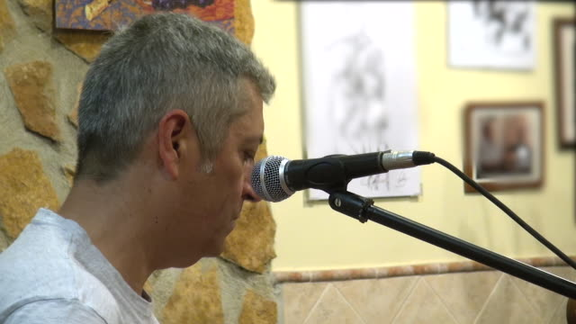 jose luis palomares rodriguez playing spanish folk rock music on guitar in a small town in spain - music style stock videos and b-roll footage