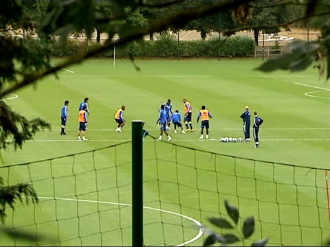 chelsea training england surrey cobham ext long shots of chelsea football players on pitch during training session trees in foreground only michael... - cobham surrey stock videos and b-roll footage
