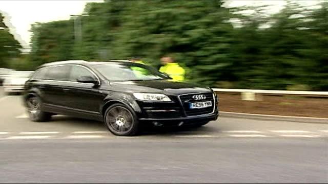 jose mourinho leaves chelsea fc by 'mutual consent' england surrey cobham jose mourinho's audi car leaving training ground - cobham surrey stock videos and b-roll footage