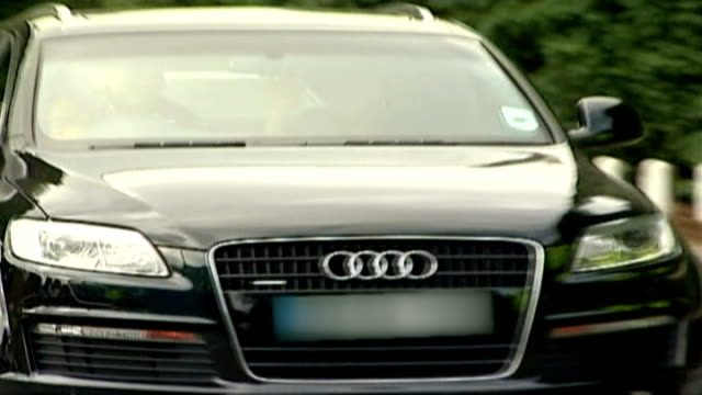 jose mourinho leaves chelsea fc by 'mutual consent' surrey cobham mourinho waving from passenger seat of audi car leaving training ground - cobham surrey stock videos and b-roll footage