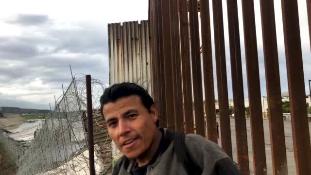 jose, who was deported from america one year ago while living with his family in nevada, stands near a border fence on the tijuana border with... - government shutdown stock videos & royalty-free footage