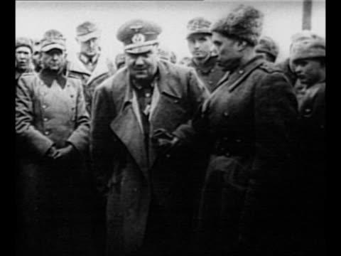 stockvideo's en b-roll-footage met josef kramer commander of bergenbelsen camp with allied guard / montage nazi major general ernst mattern commander of the camp at posen in allied... - holocaust