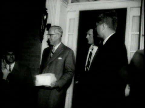 joseph kennedy john f kennedy and robert f kennedy exiting a building and getting into a car / united states - generalstaatsanwalt stock-videos und b-roll-filmmaterial