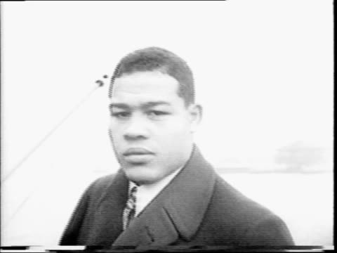 joseph louis barrow aka joe louis on ferry in street clothes / walking off ferry / louis getting his army physical measuring height examining chest /... - army stock videos & royalty-free footage