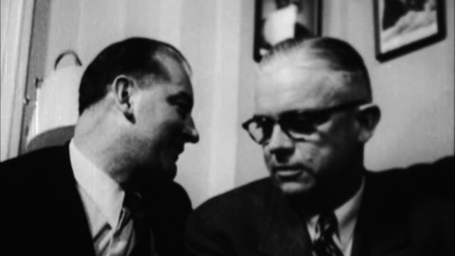 joseph mccarthy talking with other men / washington d - joseph raymond mccarthy video stock e b–roll