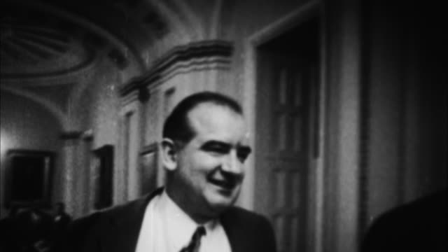 joseph mccarthy walking down hallway / washington d - anno 1954 video stock e b–roll