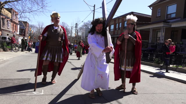 Joseph Rauti carries the Christian cross during the procession in Holy Week