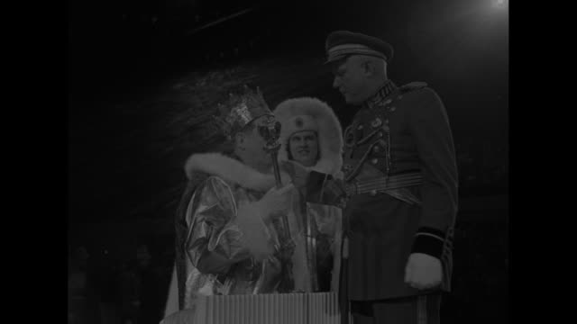 joseph rogers wearing crown and costume of king boreas waves scepter / man places crown of king boreas on rogers' head / closer view of crown being... - hands behind head stock videos and b-roll footage