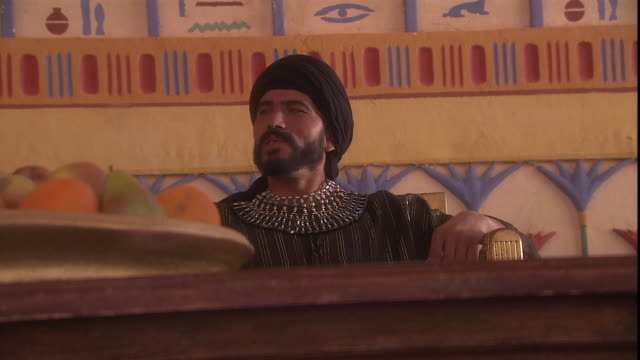joseph sits on a throne as he listens to his brother's plea. - historical reenactment stock videos & royalty-free footage