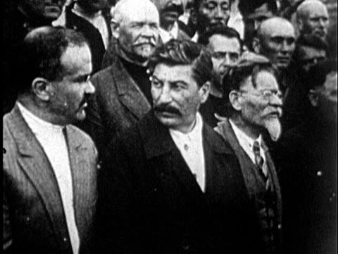 1925 b/w ms joseph stalin and leon trotsky talking with crowd behid them / soviet union - socialism stock videos & royalty-free footage