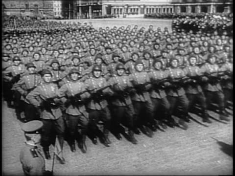 joseph stalin and semion budienny saluting / tanks driving on parade / russian army marching in formation / map of red army traveling from russia to... - 1945 stock videos & royalty-free footage