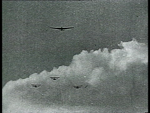 stockvideo's en b-roll-footage met joseph stalin, sergo ordzhonikidze, nikita khrushchev and kliment voroshilov visiting air show, airplane taking off at airfield / moscow, russia - 1936