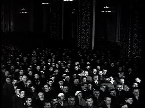 stockvideo's en b-roll-footage met joseph stalin smiling an talking with sergey kirov, lazar kaganovich, kliment voroshilov and sergo ordzhonikidze, speakers talking at party congress,... - 1934