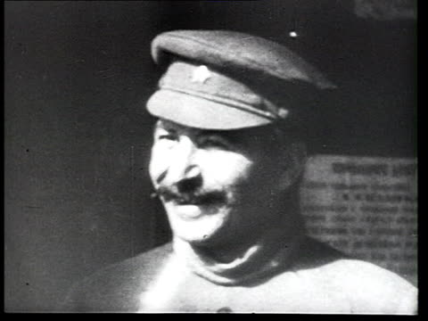 vídeos de stock, filmes e b-roll de joseph stalin smiling standing outside building during xii party congress sergo ordzhonikidze joining and both men leaving frame / moscow russia - 1923
