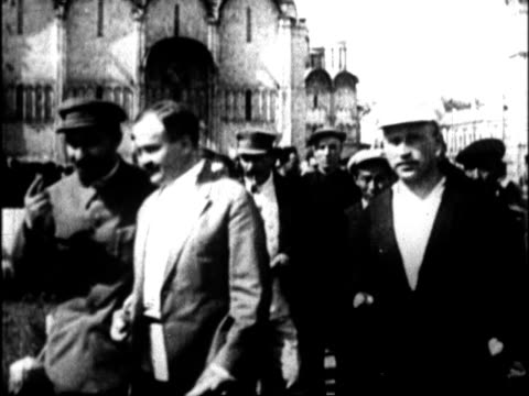 joseph stalin walking with vyacheslav molotov and other men on inspection tour of soviet agricultural farming operations joseph stalin and vyacheslav... - vyacheslav m. molotov stock videos and b-roll footage