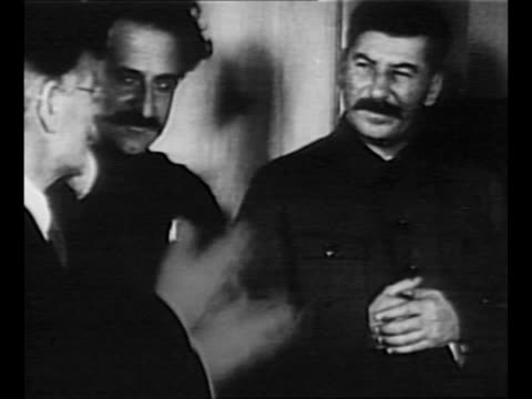 Joseph Stalin with political comrades Mikhail Kalinin and Sergo Ordzhonikidze circa 1930 pan to show Kliment Voroshilov at Stalin's left / from...