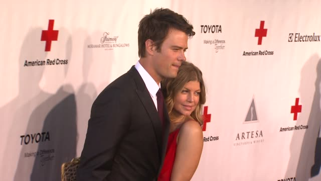 josh duhamel, fergie at the the american red cross santa monica chapter's annual red tie affair at santa monica ca. - american red cross stock videos & royalty-free footage