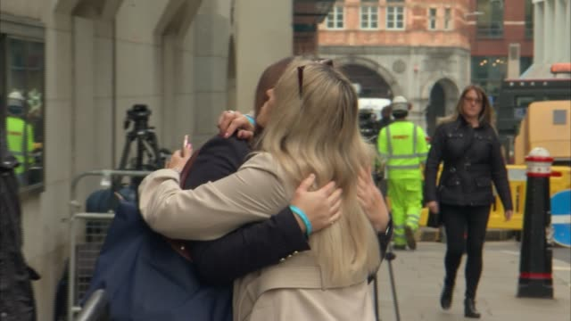 shane o'brien sentenced for life england london old bailey ext tracey hanson hugging unidentified woman outside court - courthouse stock videos & royalty-free footage
