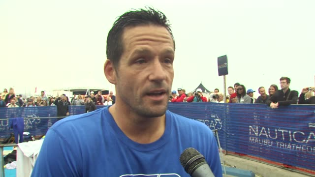 josh hopkins on how his swim went on how he trained at the 24th annual nautica malibu triathlon at malibu ca - nautica malibu triathlon stock videos & royalty-free footage