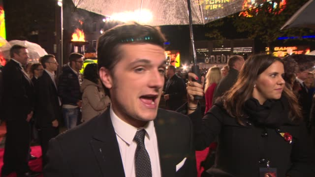 interview josh hutcherson on his spandex outfit and jennifer at 'the hunger games catching fire' premiere on november 11 2013 in london england - lycra stock-videos und b-roll-filmmaterial