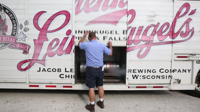 josh mccartney a driver with baumgarten distributing co makes deliveries in chillicothe illinois us on thursday sept 17 2015 shots various shots of... - anheuser busch inbev stock videos and b-roll footage