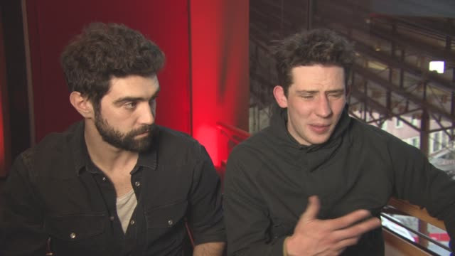 vídeos de stock, filmes e b-roll de interview josh o'connor on his character at berlin film festival 'gods own country' interviews at berlinale palast on february 15 2017 in berlin... - alec secareanu