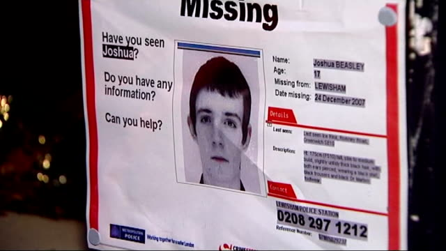 family and police appeal for information 'missing' poster in window / police sign appealing for information - missing poster stock videos & royalty-free footage