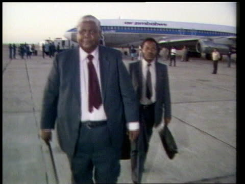 joshua nkomo retains his seat in parliament c c4n lib harare airport ext track joshua nkomo zimbabwe opposition ldr with aide walking from aircraft /... - joshua nkomo stock videos & royalty-free footage