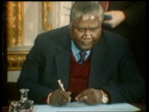 joshua nkomo retains his seat in parliament lib london lancaster house agreement signed by nkomo and robert mugabe zimbabwe pm / zimbabwe ext ms... - 1979 stock videos & royalty-free footage