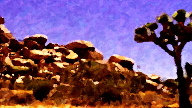 joshua trees and rock formations look like a moving impressionistic painting. - 熱帯の低木点の映像素材/bロール