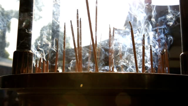 hd: joss stick and candle flame - incense stock videos & royalty-free footage