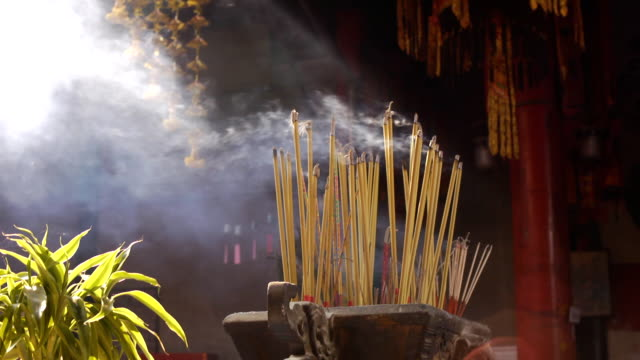 joss sticks burn at a chinese temple - buddhism stock videos & royalty-free footage