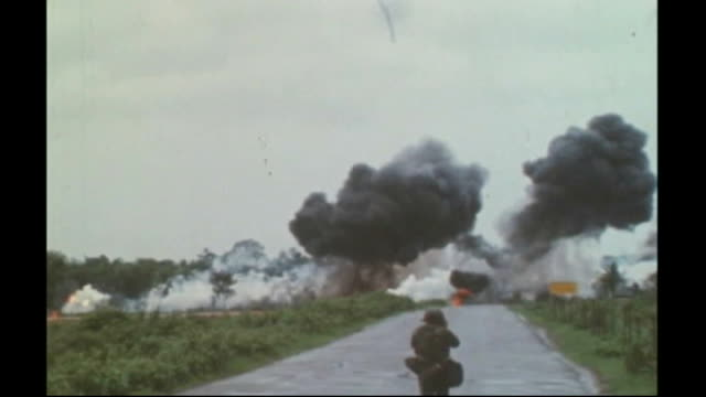 Exhibition about war correspondents at Imperial War Museum North FILE / 961972 Napalm bomb dropped on road as photographer stands in road taking...