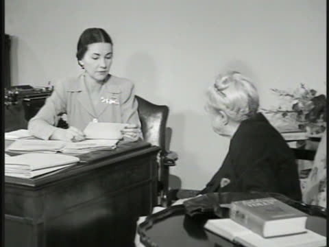 journalist advice columnist dorothy dix sitting in chair w/ secretary at desk sot reading letter miss dix saying writer is 'wasting time on married... - columnist stock videos & royalty-free footage