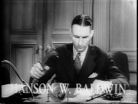 journalist hanson w baldwin, in an office, addresses the camera on current war events. - war stock-videos und b-roll-filmmaterial