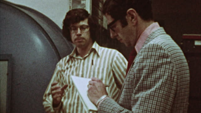 zi, cu, journalist interviewing engineer, 1970's, los angeles, california, usa - 1973 stock videos & royalty-free footage