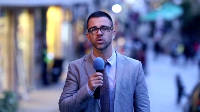 journalist reporting live in tv news  newscaster - tv reporter stock videos & royalty-free footage