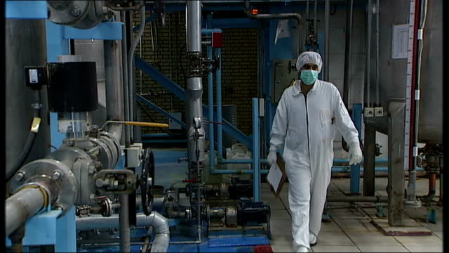 journalists and international observers tour of esfahan nuclear facility iran esfahan int workers wearing white protective suits and face masks stood... - イラン点の映像素材/bロール