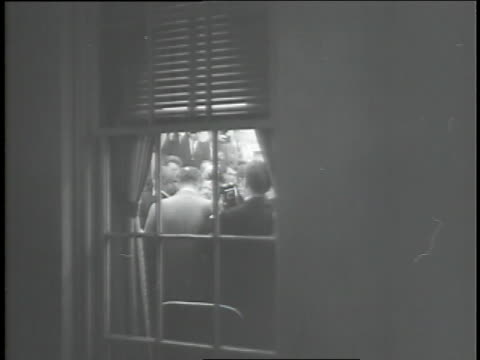 journalists appear in lighted white house windows during lyndon johnson's first night as u.s. president following the assassination of president john f. kennedy. - us president stock videos & royalty-free footage